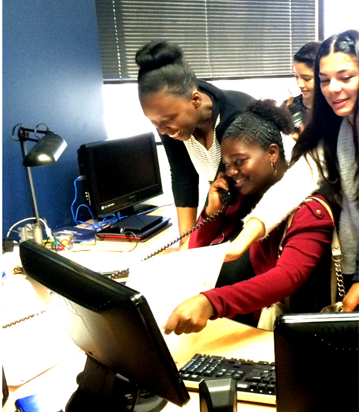 Students and a teacher work at a computer at Jessie Nelson Middle School as part of the Education Equals Opportunity, Too, Foundation program at Long Beach schools. (Courtesy photo)
